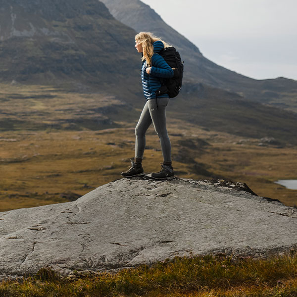 A woman standing on a rock